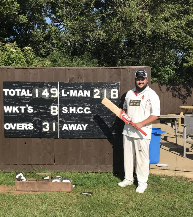 Stanton Harcourt's Ryan Lewis poses with the scoreboard
