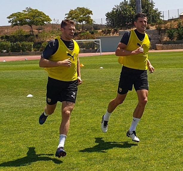 Jamie Mackie and John Mousinho are put through their paces in the Portuguese heatPicture: OUFC