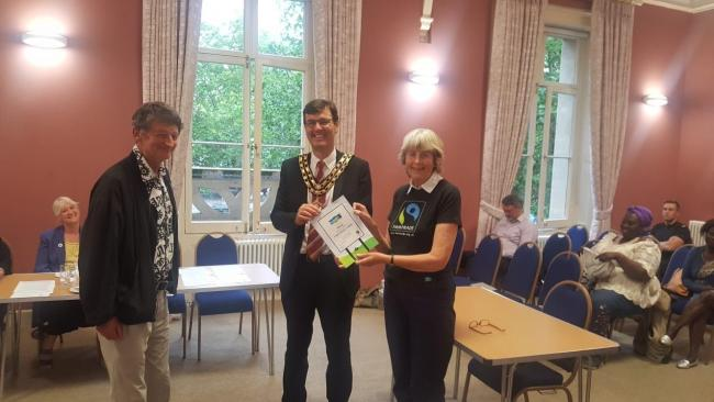 Witney mayor Duncan Enright, centre, receives the Fairtrade certificate from WAFTAG Picture: WAFTAG