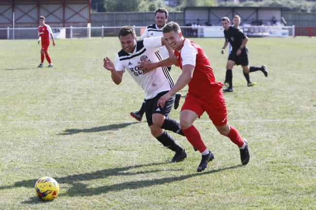 Didcot Town (in red) in FA Cup preliminary round action last season   Picture: Ed Nix