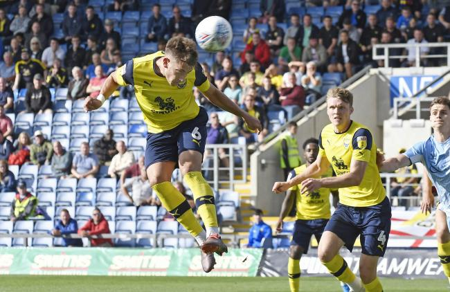 Alex Gorrin comes close to scoring for Oxford United with this header in the second half against Coventry City  Picture: David Fleming