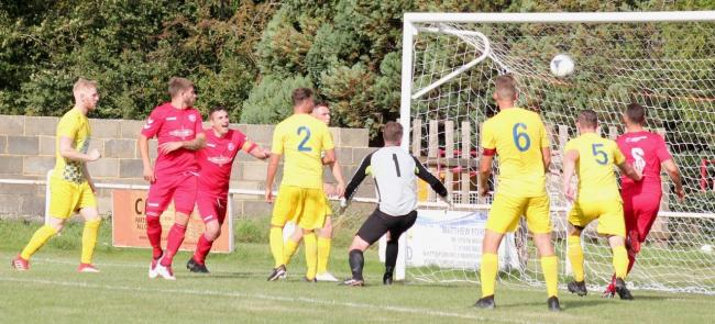 Hat-trick hero Michael Duerden heads home his second and Clanfield's fifth Picture: Paul Gibbens
