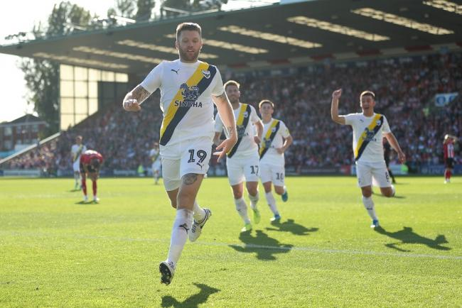 Jamie Mackie celebrates scoring at Lincoln Picture: James Williamson