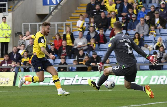 Matty Taylor beats goalkeeper Jack Bonham to put Oxford United 2-0 ahead  Picture: David Fleming
