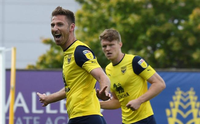 James Henry celebrates opening the scoring for Oxford United against Gillingham  Picture: David Fleming