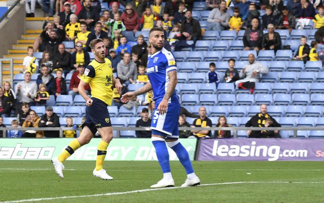 James Henry watches on as his header goes in for the Oxford United midfielder's second goal against Gillingham last weekend 	 Picture: David Fleming