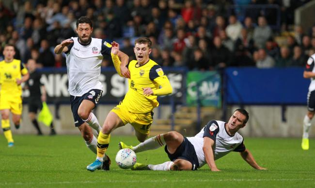 Oxford United's Ben Woodburn is brought down during the draw at Bolton Wanderers last month  Picture: Richard Parkes