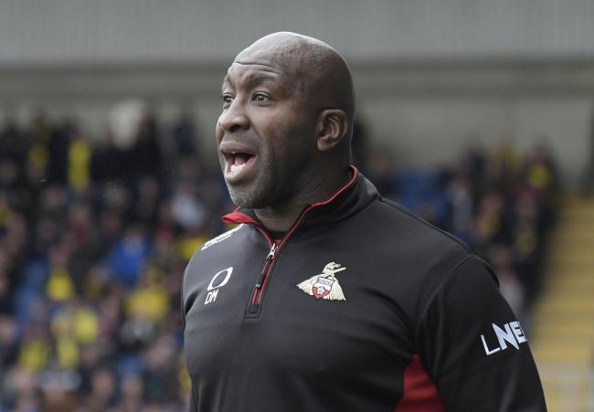 Doncaster Rovers boss Darren Moore watches his side at Oxford United   Picture: David Fleming