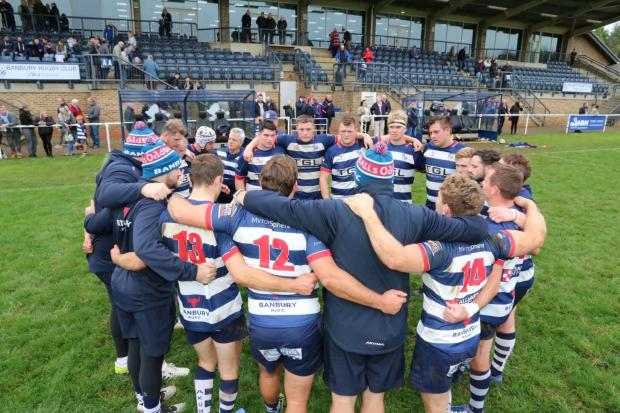 Banbury's players and coaching staff in a huddle at Saturday's gamePicture: Simon Grieve