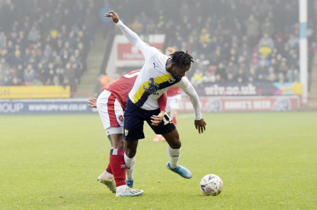 Oxford United's Tariqe Fosu is held up by Walsall in the first half  Picture: David Fleming