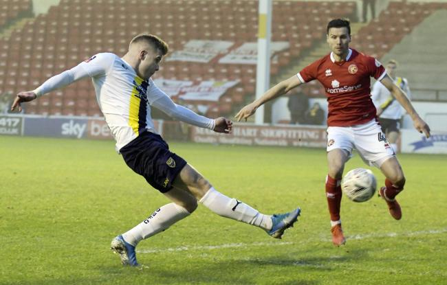 Chris Cadden sends in a cross during Oxford United's Emirates FA Cup win at Walsall  Picture: David Fleming