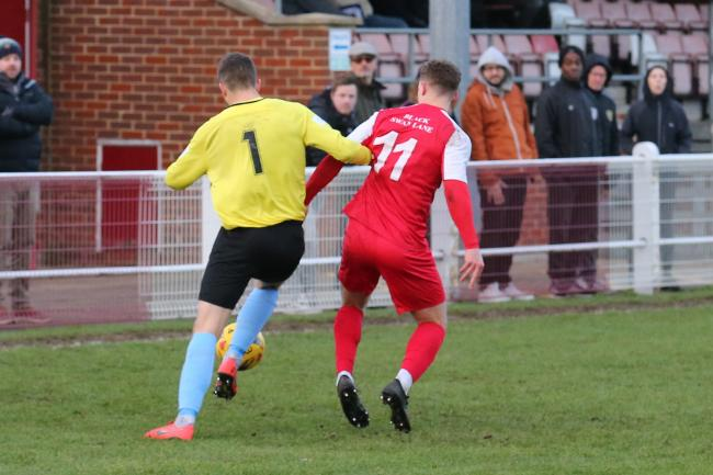 Didcot's George Reid challenges Corby goalkeeper Alastair Worby Picture: Roger Neal