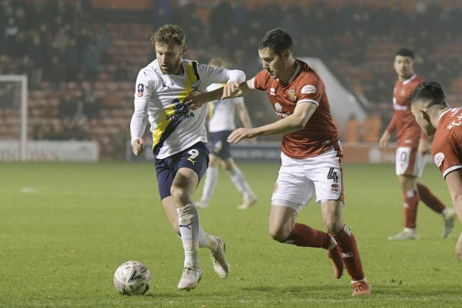 Matty Taylor on the attack for Oxford United in Saturday's second-round FA Cup win at Walsall   Picture: David Fleming