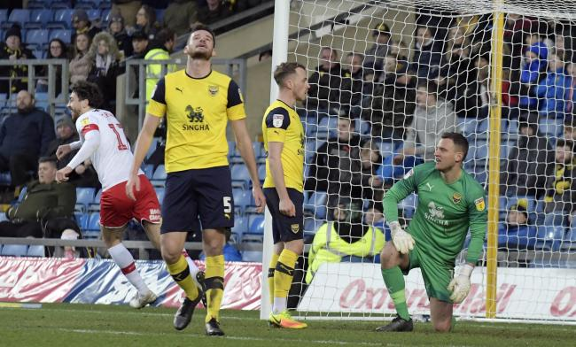 Marcus Browne motivates the Oxford United fans after scoring what proved to be a consolation goal against Rotherham United, while right, U's players react to going 3-0 down in the first half Pictures: David Fleming