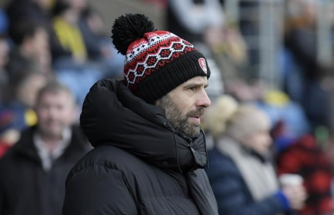 Rotherham United manager Paul Warne watches on