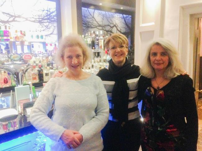 Kate Farquhar-Thomson (left) Caroline Priday and Sarah Caro in the gin bar at The Feathers Hotel
