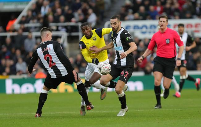 Oxford United's Shandon Baptiste is brought down by Ciaran Clark in the goalless draw at Newcastle United   Picture: Richard Parkes