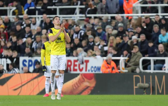 Alex Gorrin applauds Oxford United's travelling support at Newcastle United  Picture: Richard Parkes
