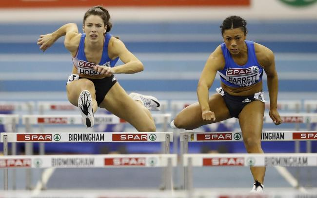 Alice Hopkins (left) in the 60m hurdles at last year's British Indoor Championships. The versatile athlete will represent England in the long jump at the European Indoor Championships this weekend       Picture: Martin Rickett/PA Wire