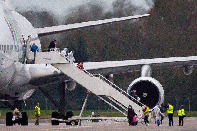 Passenger getting off Wuhan flight at RAF Brize Norton this morning. Picture: Jacob King/PA
