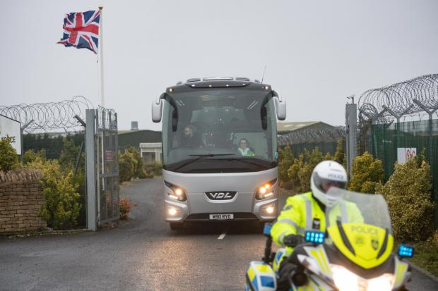 Witney Gazette: A coach leaves RAF Brize Norton with passengers from Wuhan. Picture: Jacob King/PA