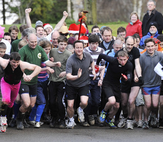 David Cameron, centre, sets off from the start line