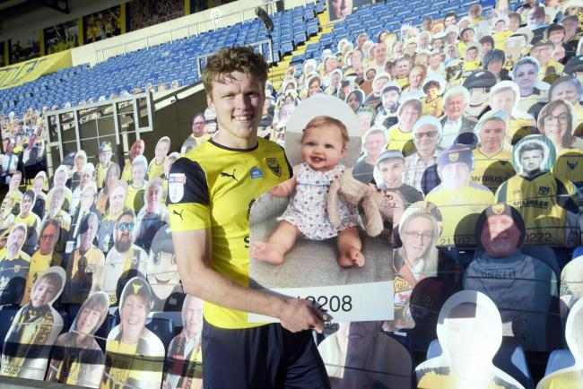 Rob Dickie's daughter Hallie was among the cardboard cut-out army at Oxford United   Pictures: David Fleming