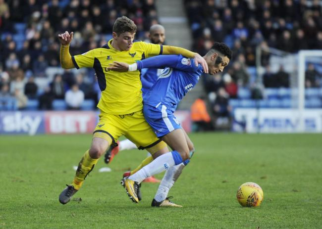 Sean Clare (right) in action against Oxford United during a loan spell with Gillingham in 2017   Picture: David Fleming
