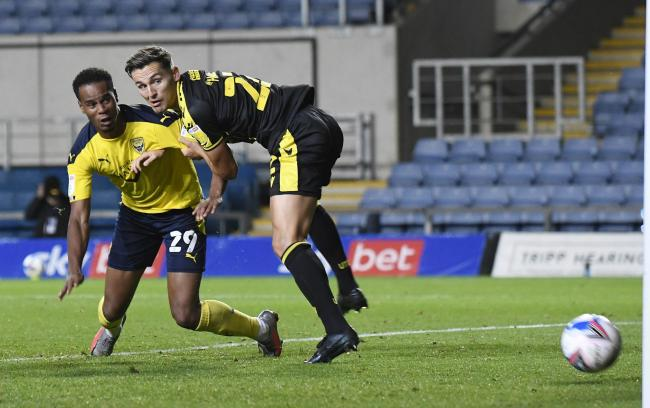 Derick Osei scores in Oxford United's group game with Bristol Rovers last month   Picture: David Fleming