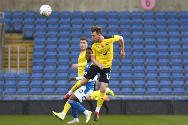 Sam Long leaps high in the air during Oxford United's Emirates FA Cup first round defeat to tonight's opponents Peterborough United in November Picture: David Fleming