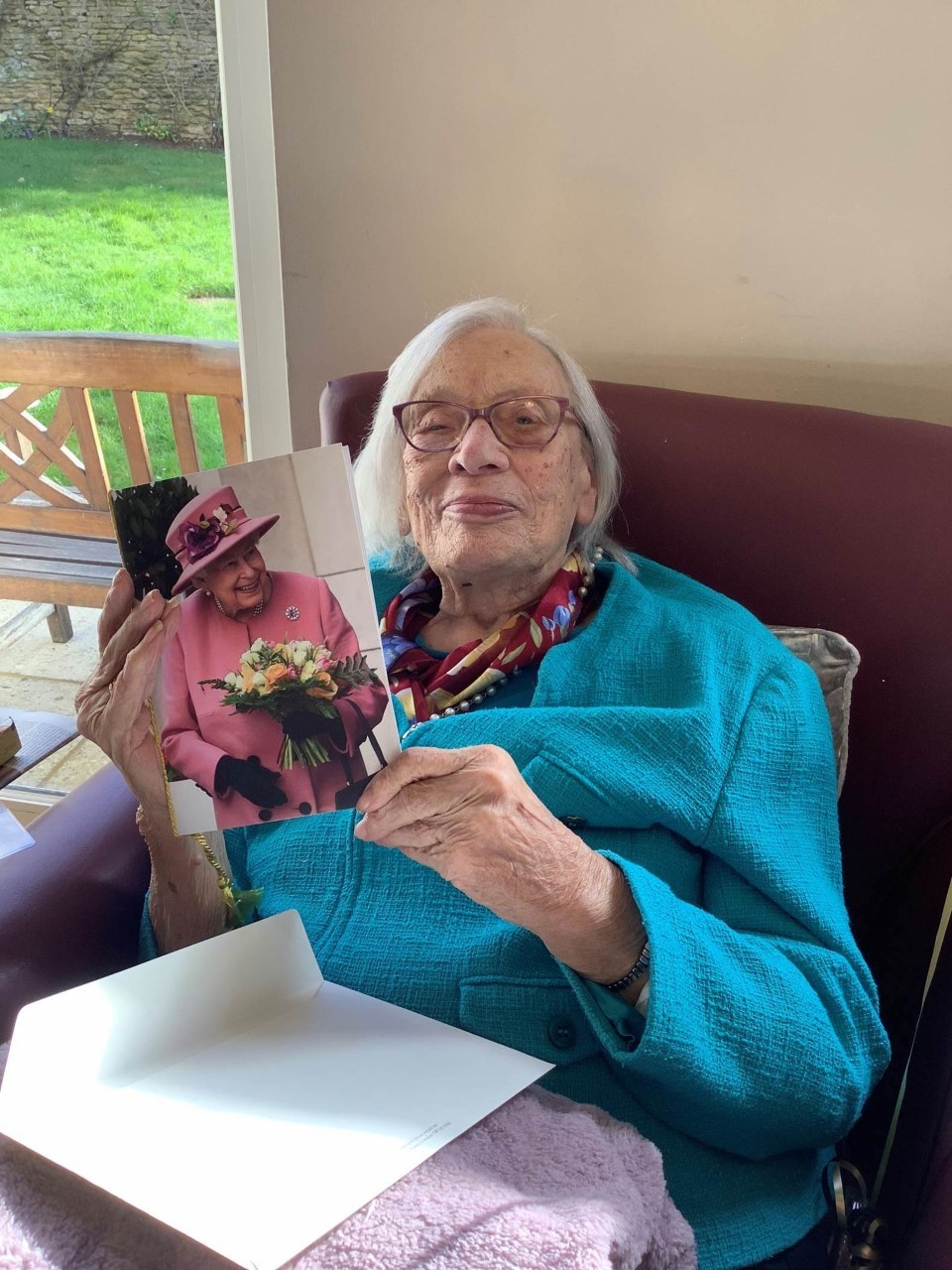 Ruby Riches celebrates her 100th birthday with her card from the Queen
