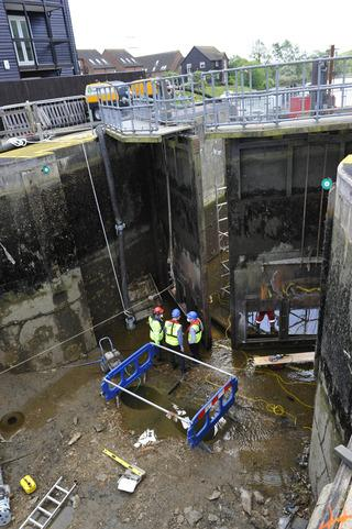 Environment Agency staff and contractors fix the faulty lock gates