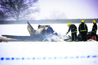 firefighters at the scene of the crash near Bladon