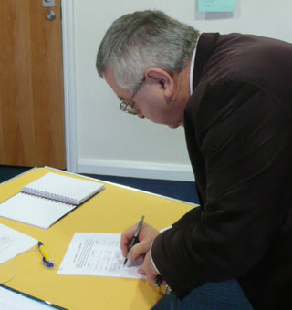 Barry Norton signs the petiton