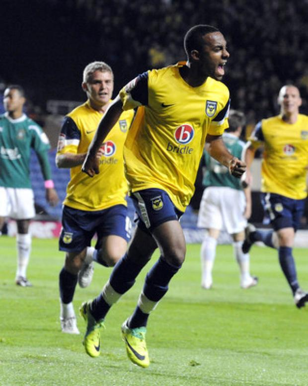 Witney Gazette: Oxford United teenager Rob Hall celebrates the first of his double against Plymouth on Tuesday night