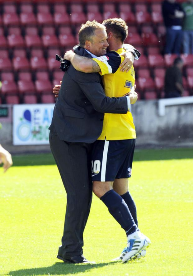 Witney Gazette: Chris Wilder and Peter Leven at the full time whistle in Swindon