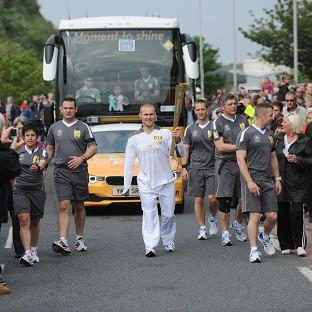 Mark Ormrod carrying the Olympic flame on the leg between Plymouth and Modbury (LOCOG/PA)