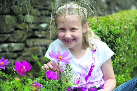 Eight-year-old Holly Evans in the gardens at Swerford Park, open to the public last weekend