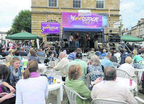 Watching the Alan Frazer Band on stage outside  Woodstock Town Hall