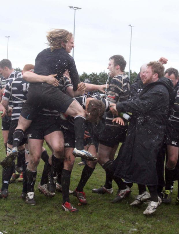 Chinnor wing Pip Seymour (left) leads the celebrations after their play-off victory over Tonbridge Juddians. Can they stay up up the third attempt?