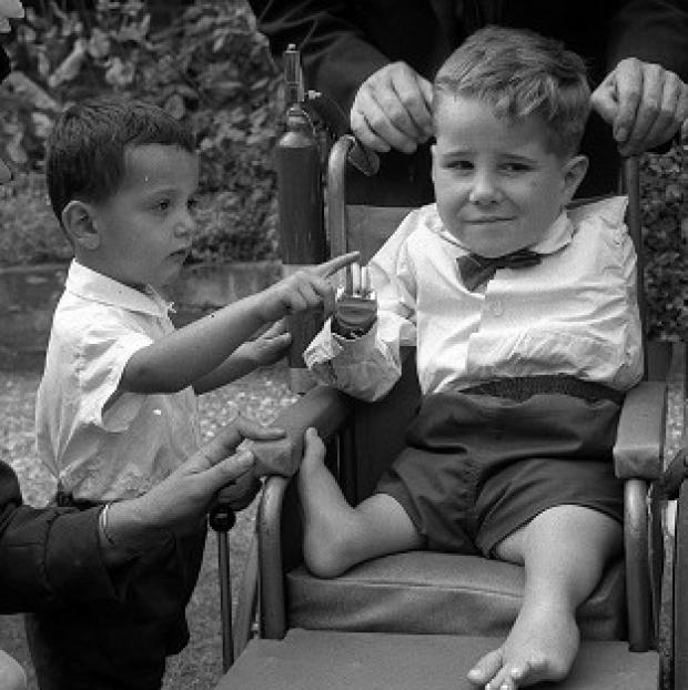 The German firm that made the drug thalidomide has apologised to people born with congential birth defects as a result of its use
