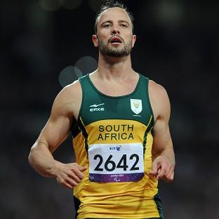 Oscar Pistorius looks dejected after finishing second in the men's 200m T44 final at the Olympic Stadium