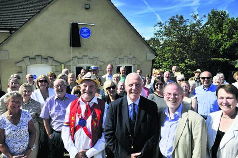 Pictured with villagers at the blue plaque unveiling are, front from left, morris dancer Gerard Robinson, Trinity College president Sir Ivor Roberts and historian Mike Heaney, Mr Tiddy's biographer