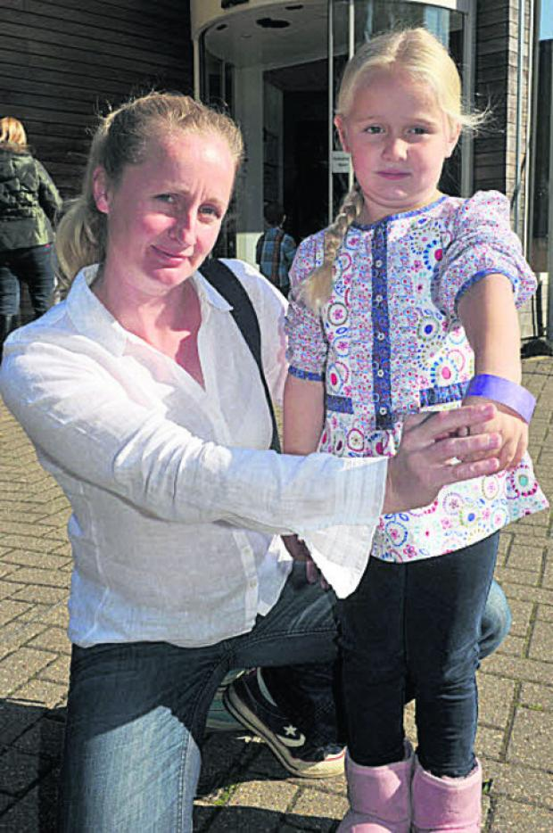 Melanie Cooke and her daughter Maisie. Picture: OX54526 Denis Kennedy