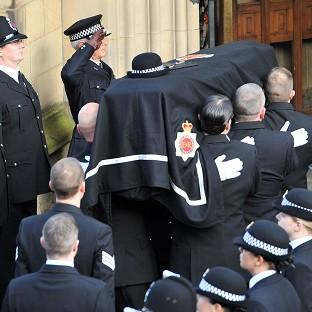 Greater Manchester Police Chief Constable, Sir Peter Fahy, salutes, as the coffin of Pc Fiona Bone is carried past