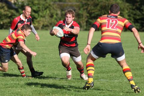Chipping Norton's Matt Dawson cuts through the Bicester backline during his side's 55-0 home victory