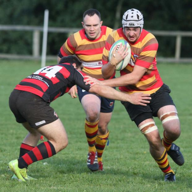 Bicester's Dean Spinks attacks against Chipping Norton