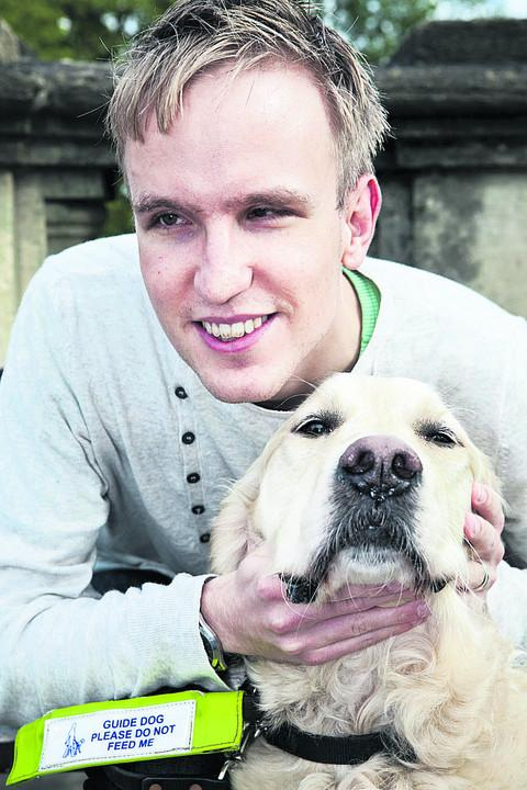 Joel Young with his guide dog Atkins