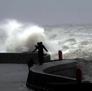 Strong westerly winds and some of the highest tides of the year could see spray coming over sea walls