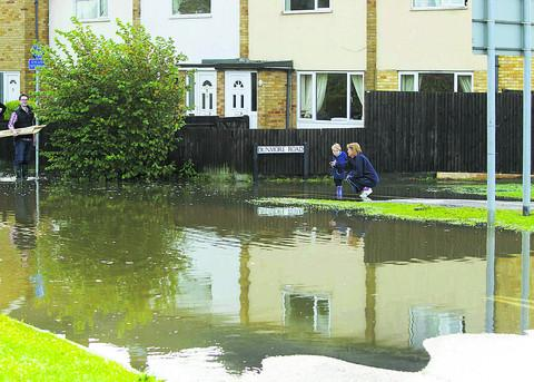 Mandy Harding shows grandson Owen Jackson flooding in Abingdon